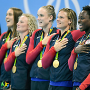 United States goalkeeper Ashleigh Johnson, right, and the rest of the USA women's water polo team sang the National Anthem during their gold medal ceremony after defeating Italy, 12-5, on Friday at Olympic Aquatics Stadium during the 2016 Summer Olympics Games in Rio de Janeiro, Brazil.
