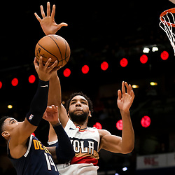 Jan 30, 2019; New Orleans, LA, USA; New Orleans Pelicans center Jahlil Okafor (8) blocks a shot by Denver Nuggets guard Gary Harris (14) during the second quarter at the Smoothie King Center. Mandatory Credit: Derick E. Hingle-USA TODAY Sports