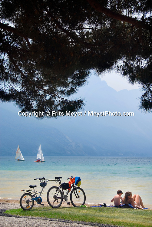 Riva del Garda, Lago di Garda, Italy, May 2009. Sailing yachts leave the marina of Riva. The town is also the base for kayaking the lake and sunbathing on the beach. The northern part of the lake area is loved by sportive people, while the south is known for its relxed atmosphere. Photo by Frits Meyst/Adventure4ever.com