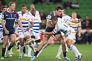 Mitch Inman (Rebels) is tackled by Juan De Jongh (Stormers) during the Round 14 match of the 2013 Super Rugby Championship between RaboDirect Rebels vs DHL Stormers at AAMI Park, Melbourne, Victoria, Australia. 17/05/0213. Photo By Lucas Wroe