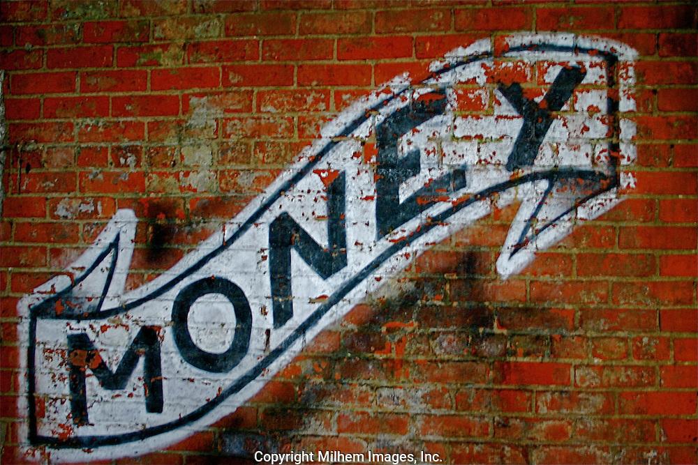 Graffiti image Money on wall of Globe Trading Company.