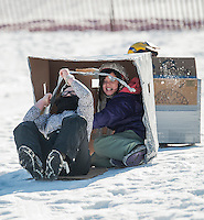 Grace Shoemaker and Teigan DiDonato made a valiant attempt to gain speed in their Zebra Sled during Wednesday's Cardboard Sled Derby with Gilford Parks and Recreation at the Gilford Outing Club.  The Zebras sled was awarded the Biggest Dud award.  (Karen Bobotas/for the Laconia Daily Sun)