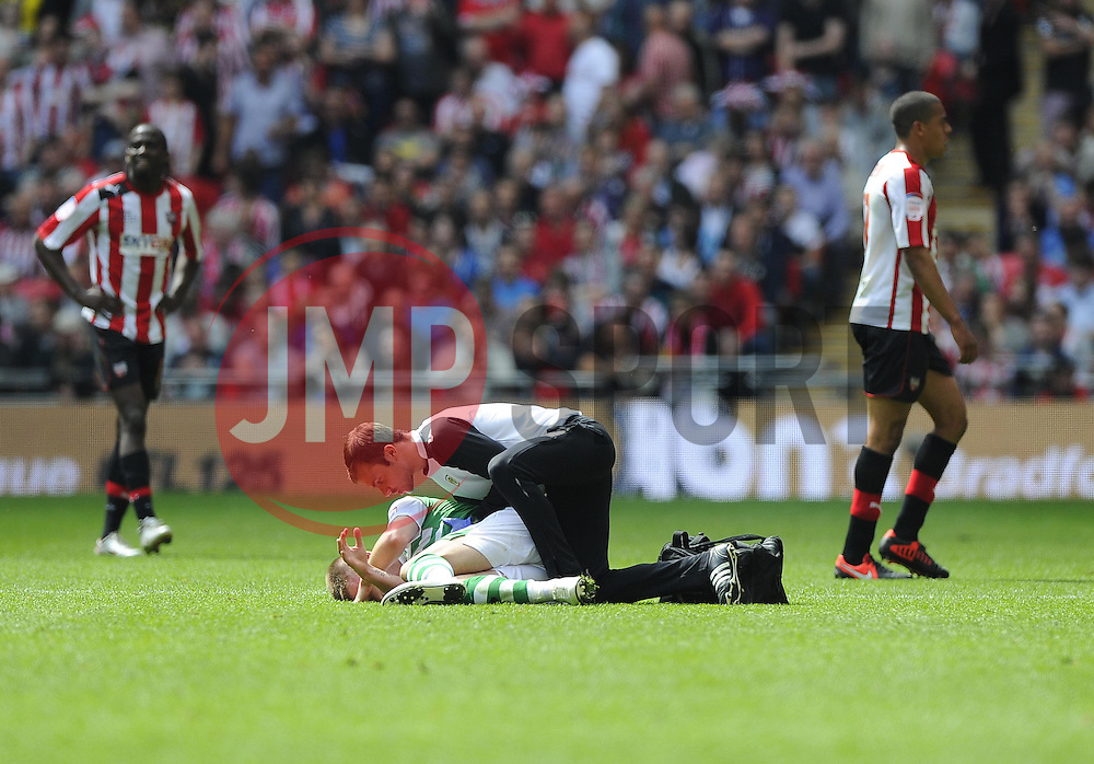 Yeovil Town's Paddy Madden receives treatment  - Photo mandatory by-line: Joe Meredith/JMP - Tel: Mobile: 07966 386802 19/05/2013 - SPORT - FOOTBALL - LEAGUE 1 - PLAY OFF - FINAL - Wembley Stadium - London - Brentford V Yeovil Town