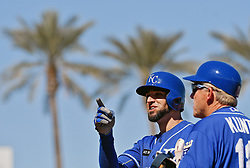 March 7, 2017 - Goodyear, AZ, USA - The Kansas City Royals' Paulo Orlando signals to the dugout after laying down a bunt single during spring training action against the Cincinnati Reds at Goodyear Ballpark in Goodyear, Ariz., on Tuesday, March 7, 2017. The Reds won, 7-3. (Credit Image: © John Sleezer/TNS via ZUMA Wire)