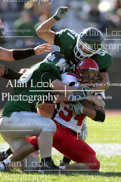 04 October 2008: Dan Rogers and Max Brooks put the stop on Jake Smith in a battle between the Carthage Red Men and the Illinois Wesleyan University Titans, Game action was at Wilder Field on the campus of Illinois Wesleyan University in Bloomington Illinois.
