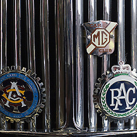 PADOVA, ITALY - OCTOBER 27:  A traditional MG car and RAC logo are seen on a vintage car on display on October 27, 2011 in Padova, Italy. The Vintage and Classic Cars Exhibition of Padova, running from the October 28 - 30, is the most important European trade show for vintage cars and motorbikes, showcasing over 1600 vehicles.