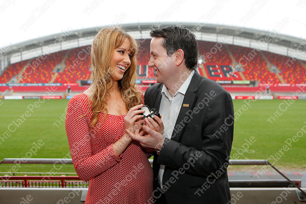 17/02/12<br /> TAKING THE LEAP: <br /> Pictured is model Becky Costello proposing to Derek Dundon of Keanes Jewellers at Thomond Park Stadium Limerick as Keanes reminds ladies that 2012 sees a Leap Year on 29th February when tradition has it, that roles are reversed and ladies can propose to men.  <br /> Picture: Don Moloney / Press 22