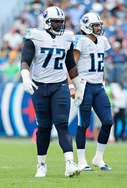 NASHVILLE, TN - OCTOBER 12:  Michael Oher #72 of the Tennessee Titans walks to the line of scrimmage during a game against the Jacksonville Jaguars at LP Field on October 12, 2014 in Nashville, Tennessee.  The Titans defeated the Jaguars 16-14.  (Photo by Wesley Hitt/Getty Images) *** Local Caption *** Michael Oher