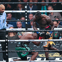 Deontay Wilder (R) knocks down Luis Ortiz during the WBC Heavyweight Championship boxing match at Barclays Center on Saturday, March 3, 2018 in Brooklyn, New York. Wilder would win the bout by knockout in the tenth round to retain the title and move to 40-0. (Alex Menendez via AP)