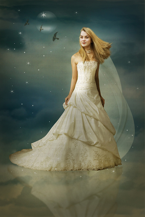 Girl with blond hair standing agianst a sky background wearing white dress