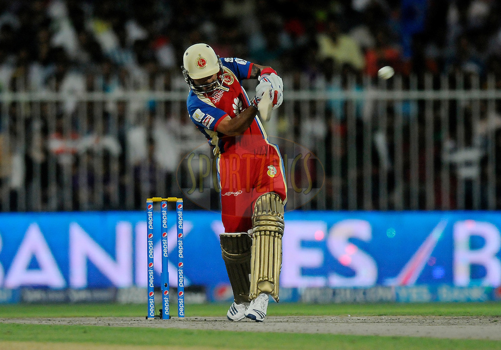Virat Kohli captain of the Royal Challengers Bangalore bats during match 11 of the Pepsi Indian Premier League 2014 between the The Royal Challengers Bangalore and the Kolkata Knight Riders  held at the Sharjah Cricket Stadium, Sharjah, United Arab Emirates on the 24th April 2014<br /> <br /> Photo by Pal Pillai / IPL / SPORTZPICS
