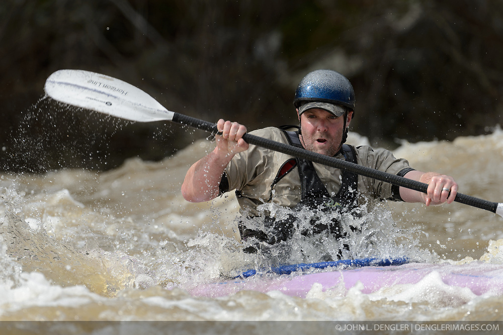Jason Bales of Farmington, Mo. practices on the slalom course prior to the start of the 45th Annual Missouri Whitewater Championships. Bales later placed second in the  K1 Men's Expert class. The Missouri Whitewater Championships, held on the St. Francis River at the Millstream Gardens Conservation Area, is the oldest regional whitewater slalom race in the United States. Heavy rain in the days prior to the competition sent water levels on the St. Francis River to some of the highest heights that the race has ever been run. Only expert classes were run on the flood level race course.