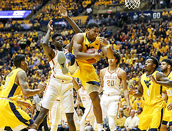 Jan 20, 2018; Morgantown, WV, USA; West Virginia Mountaineers forward Sagaba Konate (50) grabs a rebound during the first half against the Texas Longhorns at WVU Coliseum. Mandatory Credit: Ben Queen-USA TODAY Sports
