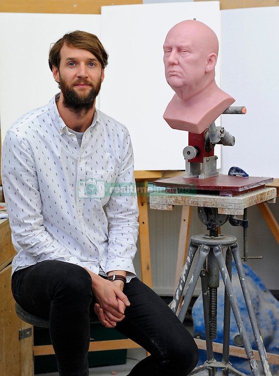 Principal Sculptor David Gardner with an unfinished wax figure of President-elect Donald Trump at the Madame Tussauds studio in west London, which will be released in January.