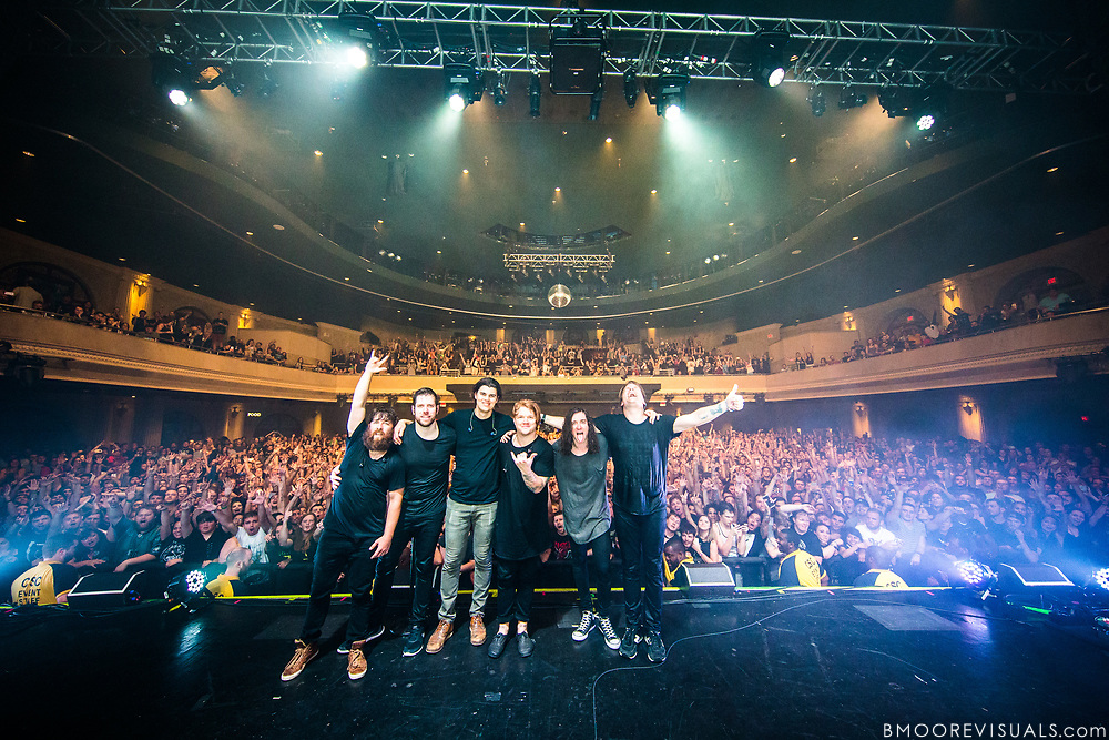 Tim McTague, Grant Brandell, James Smith, Aaron Gillespie, Spencer Chamberlain, and Chris Dudley of Underoath pose for a group shot with the sold-out crowd on April 24, 2016 at Hard Rock Live in Orlando, Florida