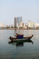 Fishing boats line the Han River in downtown Danang, Vietnam.