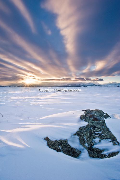 snow drifts big sky winter blizzard setting sun