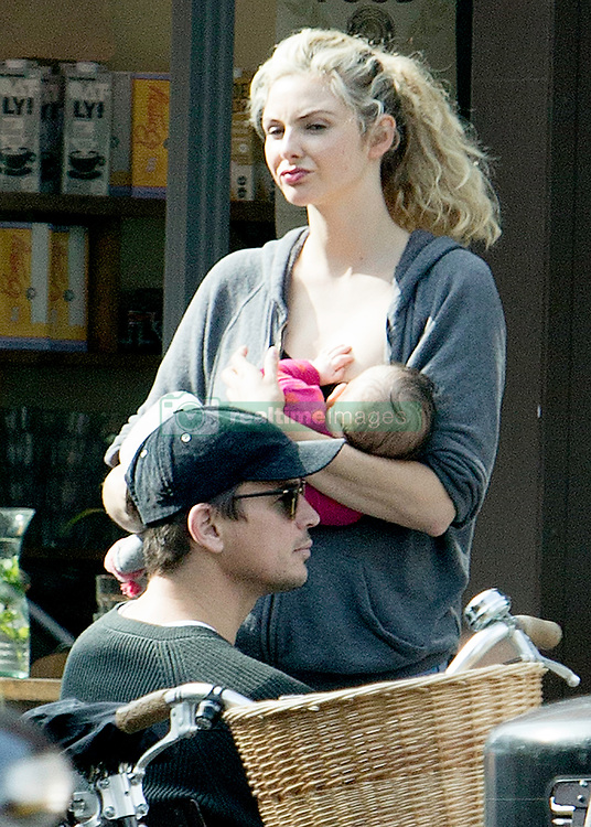 EXCLUSIVE Josh Hartnett and girlfriend Tamsin Egerton are seen enjoying the autumnal London sunshine with their baby.<br />