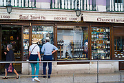 Tourists looking in window of famous Manual Tavores shop in Rua de Betesga, Praca de Figueira in Lisbon, Portugal