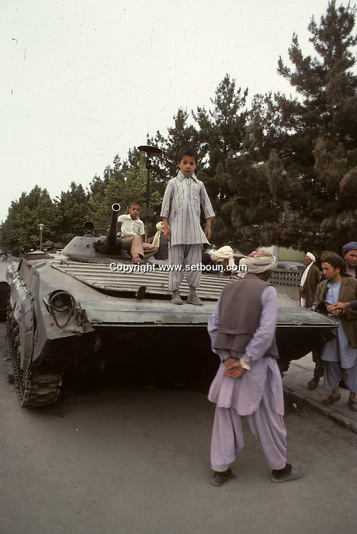 Afghanistan. after the coup d etat of the communist party against Daoud  / army and destroyed tank in front of the presidential palace  Kabul