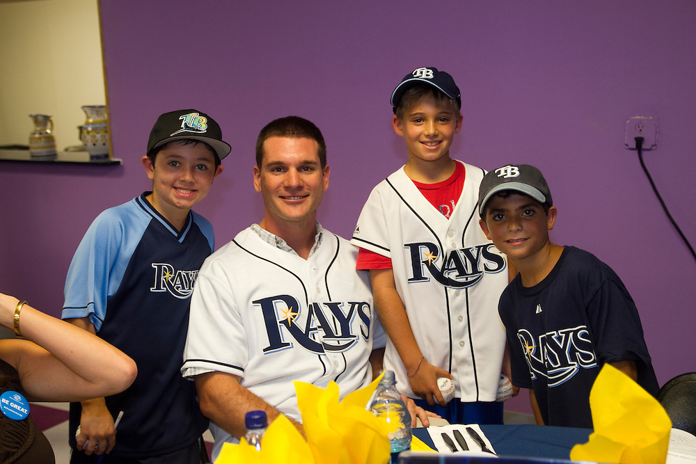 ADayWithTheRaysBoys&GirlsClub..Caption:(Friday 08/13/2010 Pinellas Park)Dominick Lee, 8, Tampa Bay Rays catcher John Jaso, Zachary Ofenloch, 9, and Justin Rudolph, 9, pose for a photo...Summary:Boys & Girls Clubs of The Suncoast event A Day With The Rays..Photo by James Branaman