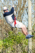 Mike Baumgardner smiles while ridding the zipline as he waits for his turn. Baumgardner came to the zipline with her father as a part of Ohio University's Dad's Weekend.