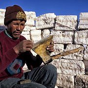 Inocencio  Flores  it sharpens an axe in a coat constructed by blocks of salt .  Salar de Uyuni ( Uyuni salt flat ) . Department  of Potos&iacute;  ( Los Lipez).  South West  Bolivia. <br /> Adult Altiplano America Andes Arid  Aridity Axe Barren  Bicycle Block  Bolivia Cleaver Color Colour Cone  Day Daytime  Department  Desert Desolate Desolation Dry  Exterior Extraction  Geography Hack Hard Hatchet  Heat Highlands  Horizontal  Human  Latin America Lake  Lined Los Lipez Male Man Men Miner Mining Nature  Resource  Natural  One Outdoors Outside  Pan People  Person Pyramide Potos&iacute;  Production  Region Resource Rural Salar de Uyuni  Salt Flat  Salt Pan  Salt lake  Scenic Seasoning  Single Shape South America  Southwest  Sud Sunglasses  Surface Travel  l West White Work  Worker Working