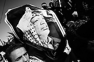 """NOTE"" small digital files !<br /> On Nov. 11 2004, Yassir Arafat died at a french military hospital. The day after, world leaders honored him at a ceromony in Cairo and afterwards his casket was brought by helicopter to his compound in Ramallah – The compound in which Israel confined him for years. Amid houndreds of thousands of  chaotic and highly emotional mourners Yasser Arafat was buried. He died at the age of 75. <br /> Mourners at the wall surrounding the Arafat compound."