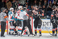 KELOWNA, CANADA - FEBRUARY 28: Keegan Kanzig #5 of Calgary Hitmen gets chippy with Madison Bowey #4 of Kelowna Rockets at the end of the second period on February 28, 2015 at Prospera Place in Kelowna, British Columbia, Canada.  (Photo by Marissa Baecker/Shoot the Breeze)  *** Local Caption *** Madison Bowey; Keegan Kanzig;