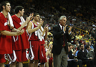 21 JANUARY 2009: Wisconsin head coach Bo Ryan and the rest of the beach applaud a basket by their team during the first half of an NCAA college basketball game Wednesday, Jan. 21, 2009, at Carver-Hawkeye Arena in Iowa City, Iowa. Iowa defeated Wisconsin 73-69 in overtime.