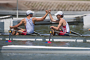 """Plovdiv BULGARIA. 2017 FISA. Rowing World U23 Championships. <br /> USA BLM4X.  WEAVER, Benjamin, CHING, Stephen, """"Fist Bump"""" befor the start of their,<br /> Thursday Repechage <br /> <br /> 12:18:21  Thursday  20.07.17   <br /> <br /> [Mandatory Credit. Peter SPURRIER/Intersport Images]."""