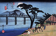 Utagawa Hiroshige 1797 – 1858) Japanese artist,,  'Man on Horseback Crossing a Bridge'. From Hiroshige's series Sixty-nine Stations of the Kisokaido (1834-1842),