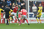 Rotherham United defender (on loan to Brighton last season) Greg Halford (15) heads towards goal during the Sky Bet Championship match between Rotherham United and Leeds United at the New York Stadium, Rotherham, England on 2 April 2016. Photo by Ian Lyall.