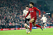 Liverpool forward Mohamed Salah (11) goes through on goal to score the winner 2-0  during the Premier League match between Liverpool and Manchester United at Anfield, Liverpool, England on 19 January 2020.
