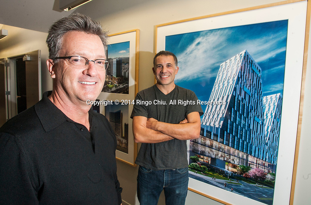 Mike Ellis, left, principle, and Ramon Hone, design principal, for 5+design architectural firm, which recently announced its design for Diamond Hill, a mixed use project in China.<br /> (Photo by Ringo Chiu/PHOTOFORMULA.com)