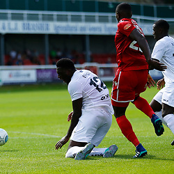Dovers forward Inih Effiong falls to the floor after a challenge from Wrexhams forward Stuart Beavon to gain a penalty  during the opening National League match between Dover Athletic and Wrexham FC at Crabble Stadium, Kent on 04 August 2018. Photo by Matt Bristow.