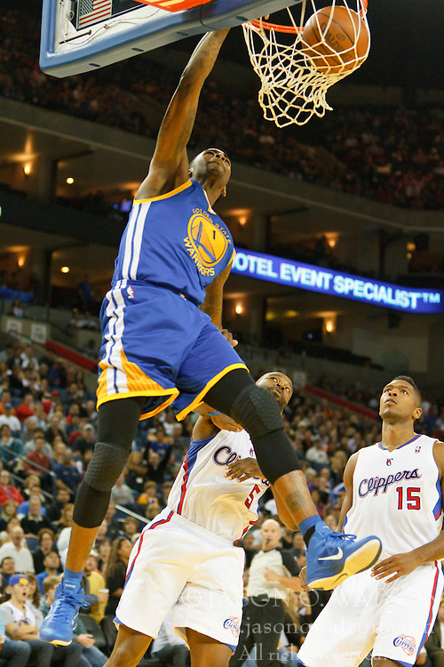 October 29, 2010; Oakland, CA, USA;  Golden State Warriors small forward Dorell Wright (1) dunks past Los Angeles Clippers point guard Baron Davis (5) and small forward Ryan Gomes (15) during the third quarter at Oracle Arena. The Warriors defeated the Clippers 109-91.