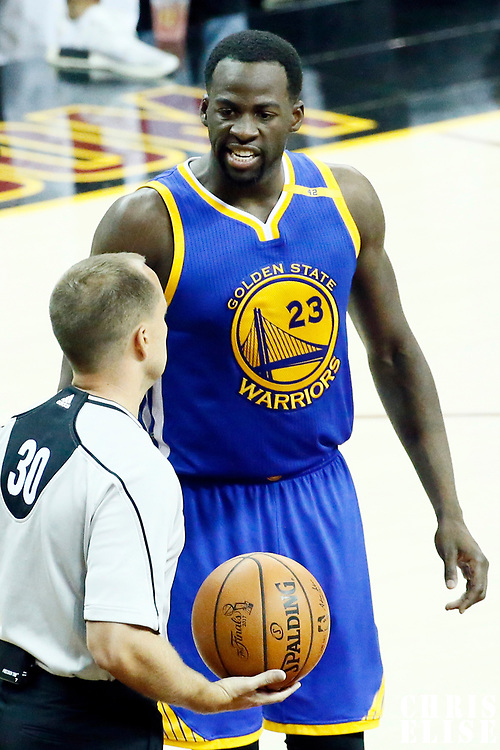 09 June 2017: Golden State Warriors forward Draymond Green (23) talks to referee John Goble (30) during the Cleveland Cavaliers 137-11 victory over the Golden State Warriors, in game 4 of the 2017 NBA Finals, at  the Quicken Loans Arena, Cleveland, Ohio, USA.