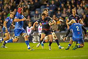 James Johnstone (#13) of Edinburgh Rugby splits the Dragons defence on his way to score a try during the Guinness Pro 14 2018_19 match between Edinburgh Rugby and Dragons Rugby at BT Murrayfield Stadium, Edinburgh, Scotland on 15 February 2019.