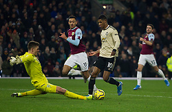 Marcus Rashford of Manchester United (R) goes round Nick Pope of Burnley to score his sides second goal - Mandatory by-line: Jack Phillips/JMP - 28/12/2019 - FOOTBALL - Turf Moor - Burnley, England - Burnley v Manchester United - English Premier League