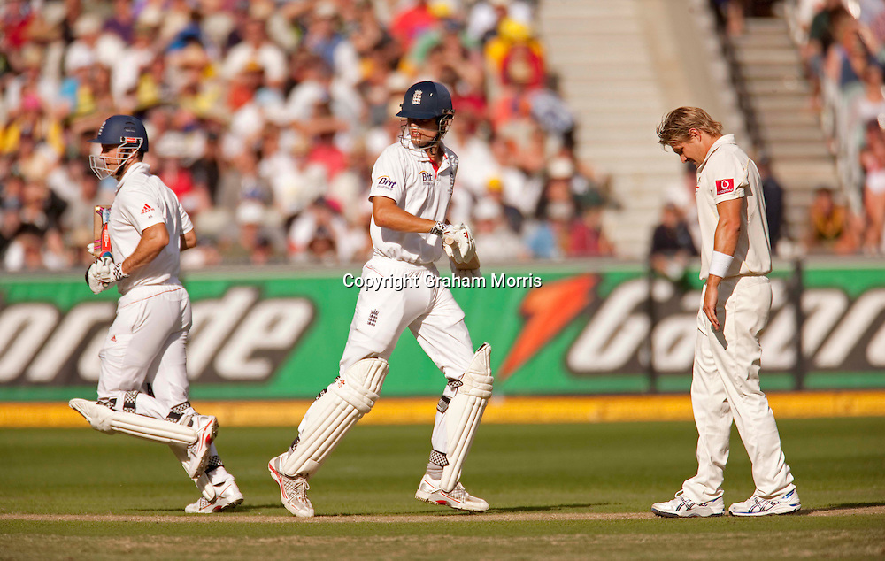 Alastair Cook and Andrew Strauss (left) run past luckless bowler Shane Watson during the fourth Ashes test match between Australia and England at the MCG in Melbourne, Australia. Photo: Graham Morris (Tel: +44(0)20 8969 4192 Email: sales@cricketpix.com) 26/12/10