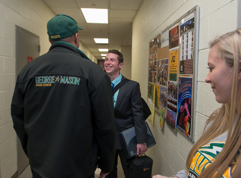 December 5, 2015 - Fairfax, VA - A day in the life of &quot;Doc Nix,&quot; aka Dr. Michael Nickens, the Director of the Athletic Bands for George Mason University. Doc Nix greets former student Joe Antonocci who is auditioning for the grad program.<br /> <br /> Photo by Susana Raab