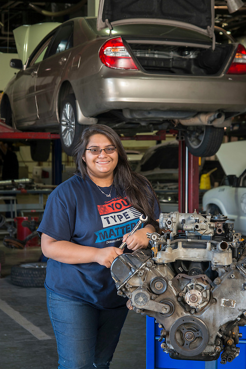 Sam Houston High School student Silvia Bustamante poses for a photograph in an auto mechanics class at the Barbara Jordan High School for Careers, November 21, 2016.
