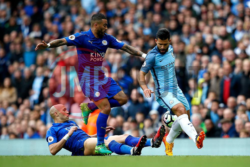 Danny Simpson of Leicester City tackles Sergio Aguero of Manchester City - Mandatory by-line: Matt McNulty/JMP - 13/05/2017 - FOOTBALL - Etihad Stadium - Manchester, England - Manchester City v Leicester City - Premier League