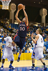 November 30, 2009; San Jose, CA, USA;  Saint Mary's Gaels center Omar Samhan (50) shoots past San Jose State Spartans guard Robert Owens (23) and guard Justin Graham (5) during the first half at the Event Center Arena.  Saint Mary's defeated San Jose State 78-71.
