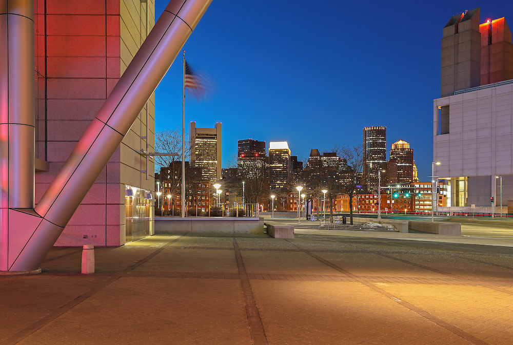 Boston skyline photo showing landmarks such as the Custom House of Boston, One International Place and The Federal Reserve Bank of Boston framed through the industrial and modern Boston Convention and Exhibition Center architecture, photographed on a stunning night at twilight. The BCEC is one of the largest convention and exhibition centers in the Northeast. This Boston skyline photography image is available as museum quality photography prints, canvas prints, acrylic prints or metal prints. Fine art prints may be framed and matted to the individual liking and decorating needs: <br />