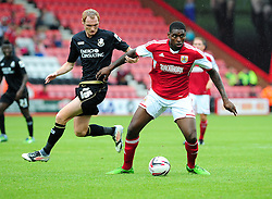 Bristol City's Jay-Emmanuel Thomas holds the ball up from Bournemouth's Shaun MacDonald - Photo mandatory by-line: Dougie Allward/JMP - Tel: Mobile: 07966 386802 27/03/2013 - SPORT - FOOTBALL - Goldsands Stadium - Bournemouth -  Bournemouth V Bristol City - Pre Season friendly