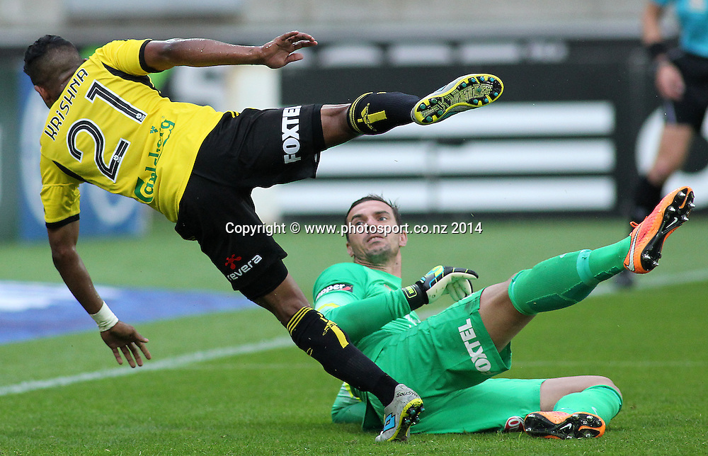 Phoenix Roy Krishna is tripped by Wanderers Ante Covic as he scores a penalty kick during the A-League football match between the Wellington Phoenix & Western Sydney Wanderers at Westpac Stadium, Wellington, 28 December 2014. Photo.: Grant Down / www.photosport.co.nz