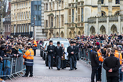© Licensed to London News Pictures. 31/03/2018. Cambridge, UK. The hearse arrives along King's Parade for the funeral of Stephen Hawking at Church of St Mary the Great in Cambridge, Cambridgeshire. Professor Hawking, who was famous for ground-breaking work on singularities and black hole mechanics, suffered from motor neurone disease from the age of 21. He died at his Cambridge home in the morning of 14 March 2018, at the age of 76. Photo credit: Rob Pinney/LNP