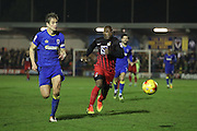 AFC Wimbledon defender Paul Robinson (6) and Coventry City forward Yakubu Ayegbini (22) during the EFL Sky Bet League 1 match between AFC Wimbledon and Coventry City at the Cherry Red Records Stadium, Kingston, England on 14 February 2017. Photo by Stuart Butcher.